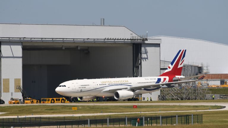 The RAF Voyager aircraft used by the Prime Minister and the royal family emerges from a hangar at Cambridge airport where it is has been repainted in the colours of the Union flag at a cost of almost 1 million.