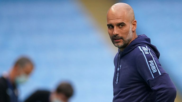 Manchester City's Spanish manager Pep Guardiola reacts in front of empty stands ahead of the English Premier League football match between Manchester City and Arsenal at the Etihad Stadium in Manchester, north west England, on June 17, 2020. - The Premier League makes its eagerly anticipated return today after 100 days in lockdown but behind closed doors due to coronavirus restrictions. (Photo by DAVE Thompson / POOL / AFP) / RESTRICTED TO EDITORIAL USE. No use with unauthorized audio, video, data, fixture lists, club/league logos or 'live' services. Online in-match use limited to 120 images. An additional 40 images may be used in extra time. No video emulation. Social media in-match use limited to 120 images. An additional 40 images may be used in extra time. No use in betting publications, games or single club/league/player publications. /  (Photo by DAVE THOMPSON/POOL/AFP via Getty Images)