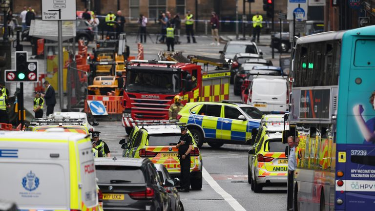 GLASGOW, SCOTLAND - JUNE 26: A general view of emergency services at the scene after reports of three people being killed in a central Glasgow hotel on June 26, 2020 in Glasgow, Scotland. A knifeman stabbed three people to death in the stairwell of the Park Inn Hotel on West George Street, Glasgow before being shot himself by armed police. The Scottish Police Federation (SPF) said an officer was stabbed during the major incident. (Photo by Jeff J Mitchell/Getty Images)