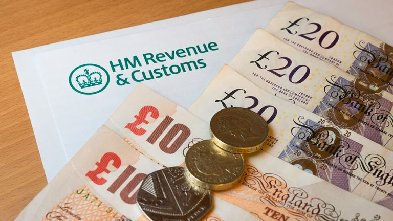 A HMRC (Her Majesty's Revenue and Customs) letter head surrounded by British bank notes and coins.