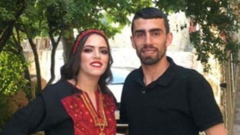 Ahmad Moustafa Erakat with one of his sisters
