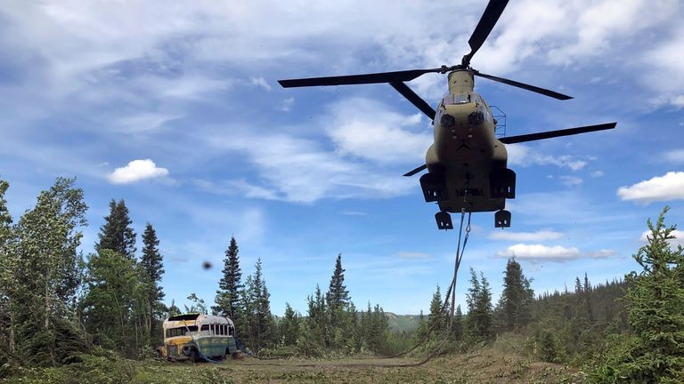 "An Alaska Army National Guard CH-47 Chinook helicopter carries the bus made famous by the ""Into the Wild"" book and movie during its relocation near Stampede Trail west of Healy, Alaska, U.S. June 18, 2020. Alaska National Guard/Handout via REUTERS. THIS IMAGE HAS BEEN SUPPLIED BY A THIRD PARTY."