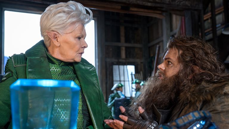 Judi Dench plays Commander Root, which was originally a male role