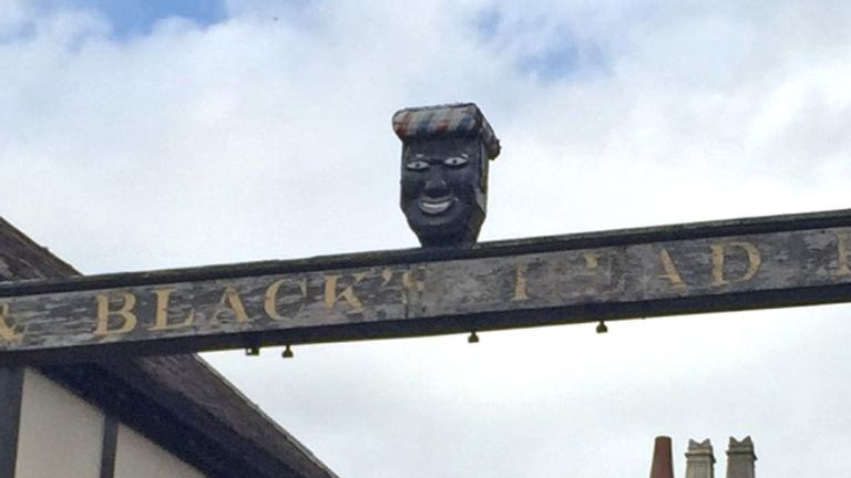 The sign for the Greenman pub in Ashbourne, Derbyshire includes a caricature of a black man's face