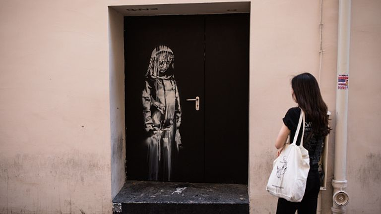 Banksy painted the mural on an emergency exit door of the Bataclan venue in Paris