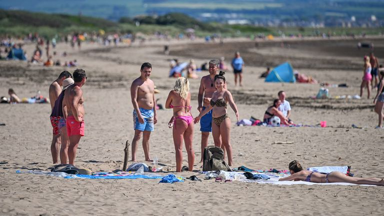 Crowds of people flocked to beaches and beauty spots across  the UK over the weekend