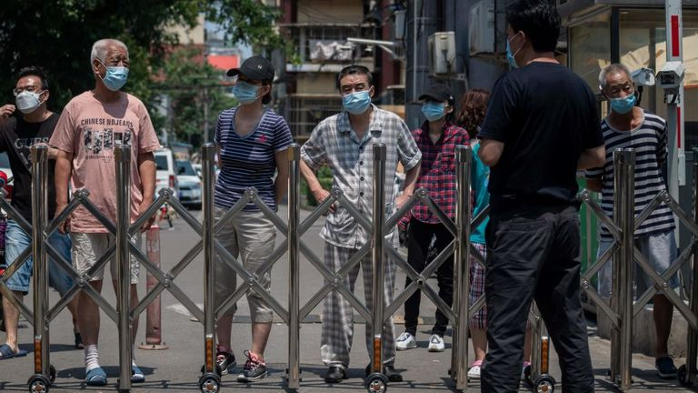 People in lockdown wait for food to be delivered in Beijing