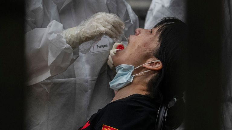 A woman is tested for the virus in Beijing