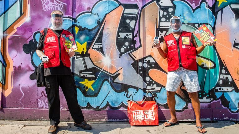 Big Issue Vendors Will Herbert (R) and Mike Danks wearing the PPE they will be using from 6 July