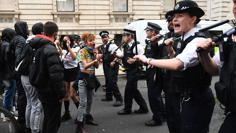 Protesters and police officers during a Black Lives Matter protest rally on Whitehall