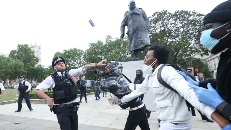 Police officers clash with protesters in Parliament Square