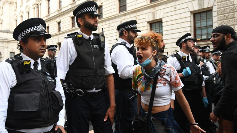 Protesters and police officers in Whitehall