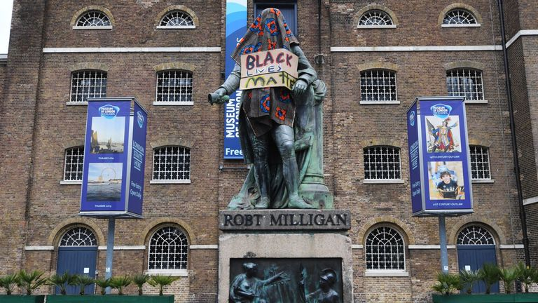 The statue of Robert Milligan, covered with a shawl and a Black Lives Matter poster, outside the Museum of London Docklands, London. Pic: James Veysey/Shutterstock