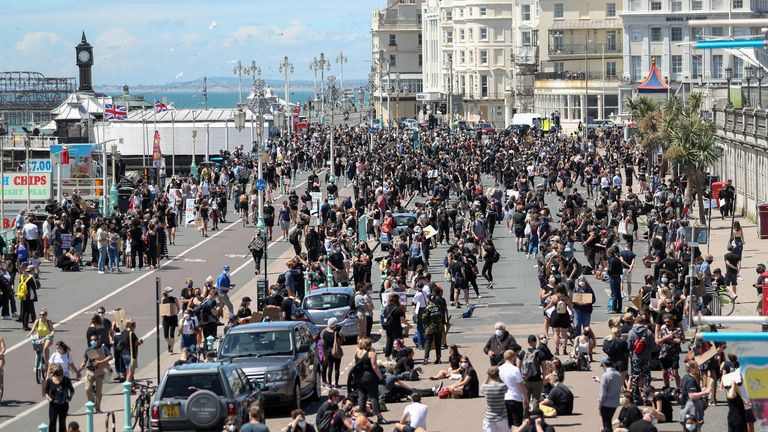 Protesters from Black Lives Matter gather on the sea front before a march in Brighton
