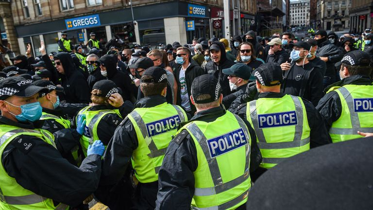 Police clashed with protesters as they tried to guide them into George Square