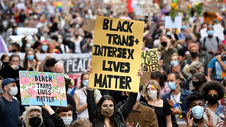 People take part in a Black Trans Lives Matter rally in London, Britain, June 27, 2020. REUTERS/Toby Melville