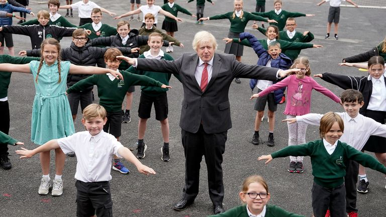 Boris Johnson practices social distancing with children on a visit to Bovingdon Primary Academy in Hemel Hempstead. Pic: Andrew Parsons / No 10