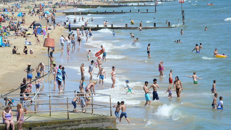 People went for a dip in Bournemouth as the Earth equalled its hottest May on record