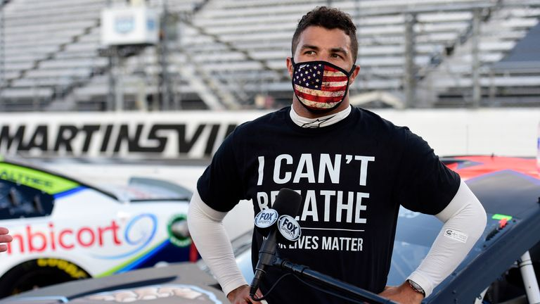 "NASCAR Cup Series Blue-Emu Maximum Pain Relief 500 MARTINSVILLE, VIRGINIA - JUNE 10: Bubba Wallace, driver of the #43 Richard Petty Motorsports Chevrolet, wears a ""I Can't Breathee - Black Lives Matter"" t-shirt under his fire suit in solidarity with protesters around the world taking to the streets after the death of George Floyd on May 25, speaks to the media prior to the NASCAR Cup Series Blue-Emu Maximum Pain Relief 500 at Martinsville Speedway on June 10, 2020 in Martinsville, Virginia. (Pho"