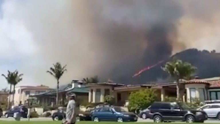 Wildfires move perilously close to houses in California