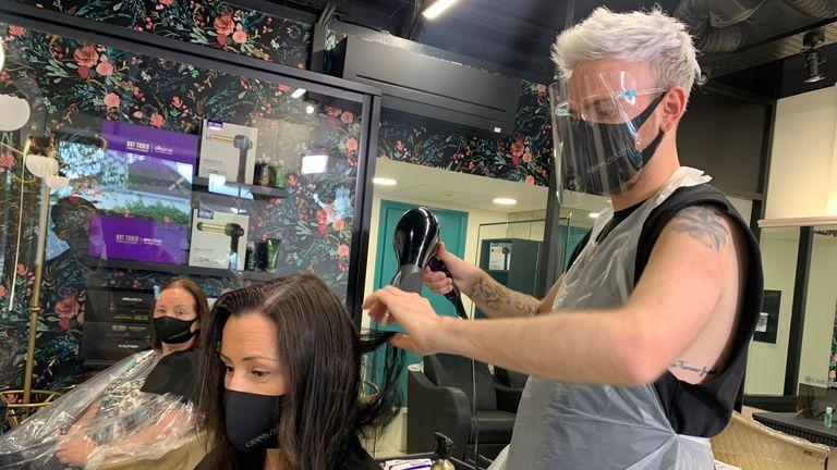 Paul Scott, a stylist, styles Fiona O'Neill's hair at the Ceira Lambert Hair Consultancy salon