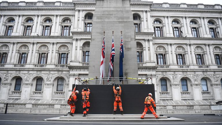 Scaffolders erect boarding around the Cenotaph on Whitehall, London