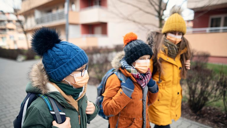 Children in coronavirus masks