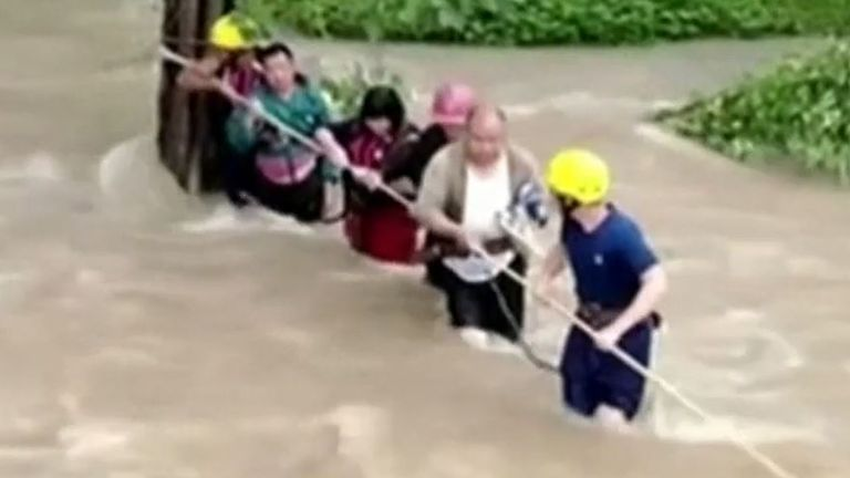 People are rescued as floods sweep across China