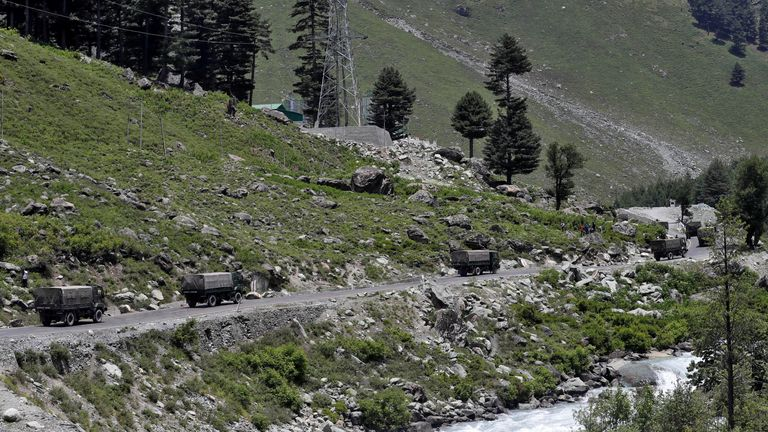 Indian army trucks move along a route leading to Ladakh at Gagangeer in Kashmir's Ganderbal district. Pic: Reuters/Danish Ismail