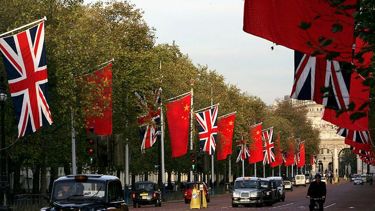 LONDON - NOVEMBER 07:  Chinese and British flags fly on Pall Mall on November 7, 2005 in London, England. The Chinese President, Hu Jintao will make a state 3 day visit to Britain on November 8. The last Chinese president to have visited was Jiang Zemin in October 1999.  (Photo by Daniel Berehulak/Getty Images)