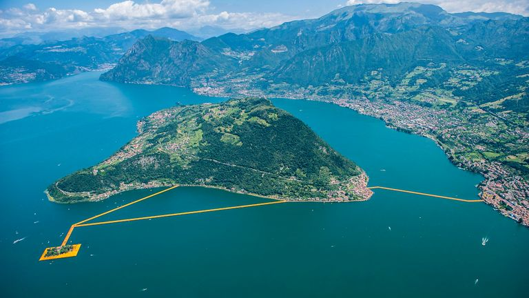 Aerial view installation view of 'The Floating Piers' made by artist Christo Vladimirov Yavachev and Jeanne-Claude Denat de Guillebon