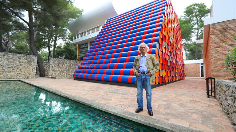 "Bulgarian artist Christo poses in front of the monumental ""Mastaba"" art work at the Maeght Foundation (Fondation Maeght) on the opening day of the exibition on June 4, 2016 in Saint-Paul-de-Vence, southeastern France"