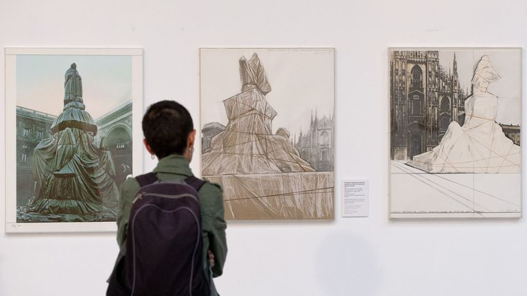 A picture taken on September 11, 2015 shows a visitor at the opening of an exhibition dedicated to Bulgarian-born artist Christo in Sofia. The first ever exhibition of avant-garde artist Christo in his native Bulgaria opened in Sofia on September 14, giving a rare insight into his spectacular wrapping projects. Christo, 80, has not returned to Bulgaria since emigrating during communism in 1958 and settling in New York in 1964 with his wife and collaborator Jeanne-Claude, who passed away in 2009.