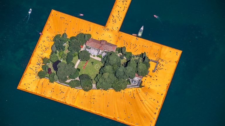erial view installation view of 'The Floating Piers' made by artist Christo Vladimirov Yavachev and Jeanne-Claude Denat de Guillebon in Italy