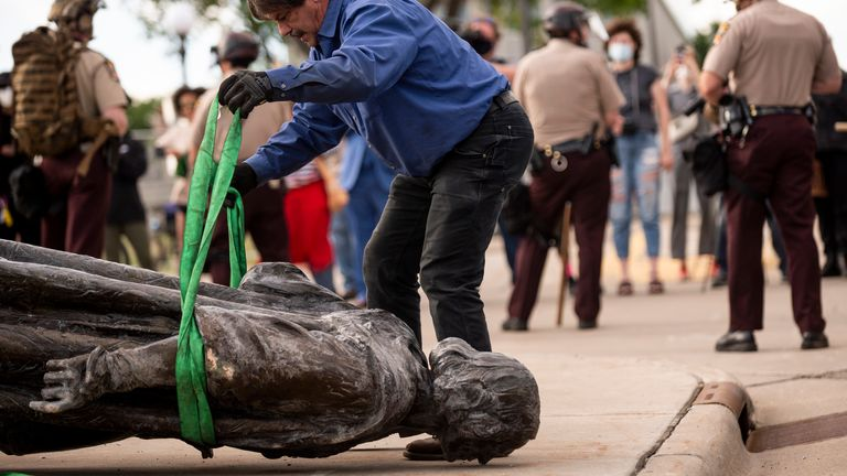 A statue of Christopher Columbus, which was toppled to the ground by protesters in St Paul, Minnesota