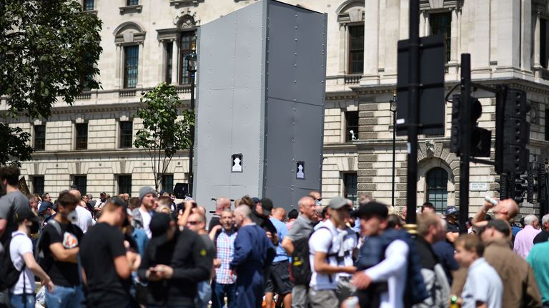 Counter-protesters gathered around the boarded-up statue of Winston Churchill in Parliament Square, London.