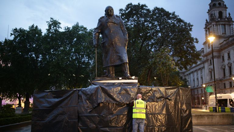 The Winston Churchill statue being cleaned on Parliament Square, London