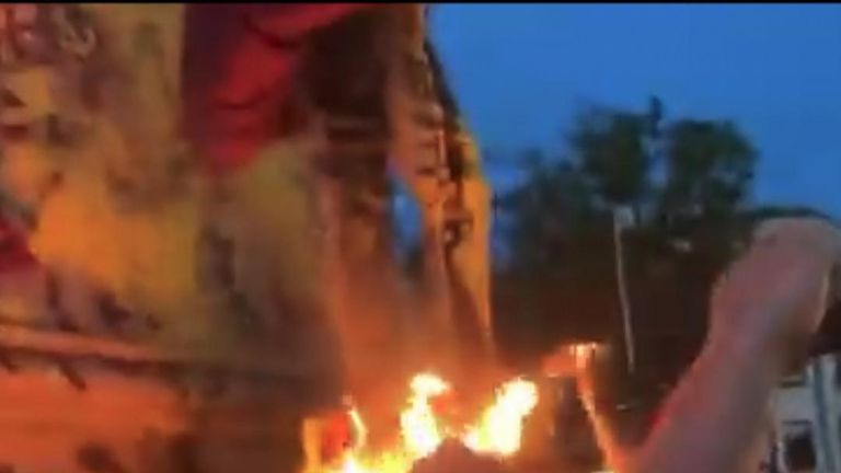 Confederate statue burns in Portsmouth, Virginia