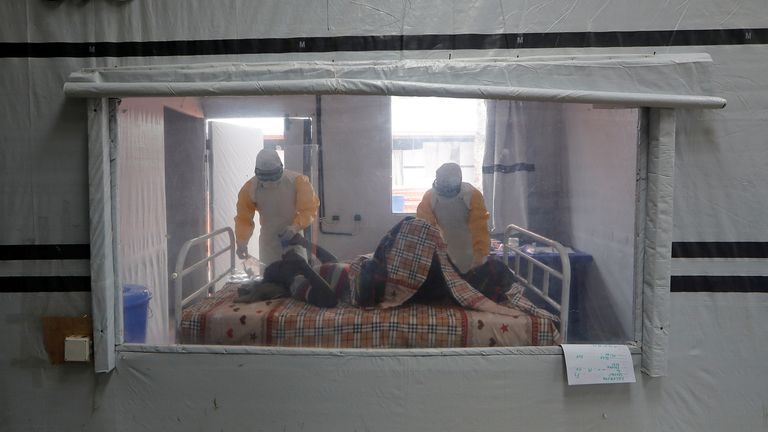 Nurses care for a patient who is suspected to be suffering from Ebola in the Democratic Republic of Congo