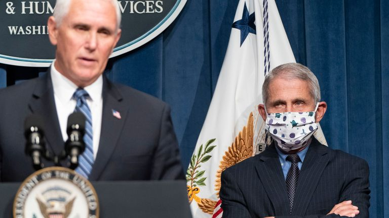 Director of the National Institute of Allergy and Infectious Diseases Anthony Fauci watches as Mike Pence speaks at a White House Coronavirus Task Force briefing