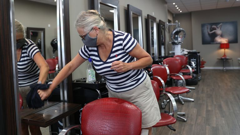 Salon manager Vicki Steventon prepares for the opening of Terry Steventon Hairdressing in Bournemouth ahead of the Prime Minister setting out plans to allow pubs, restaurants, museums and cinemas to begin reopening in the latest easing of the coronavirus lockdown in England.