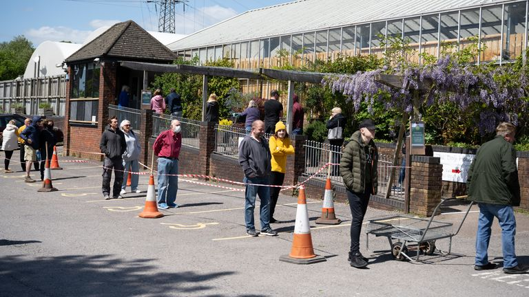 People queue at Caerphilly Garden Centre in Cardiff, Wales