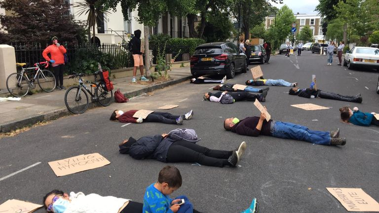 Protesters staged a 'die-in' outside Dominic Cummings's house