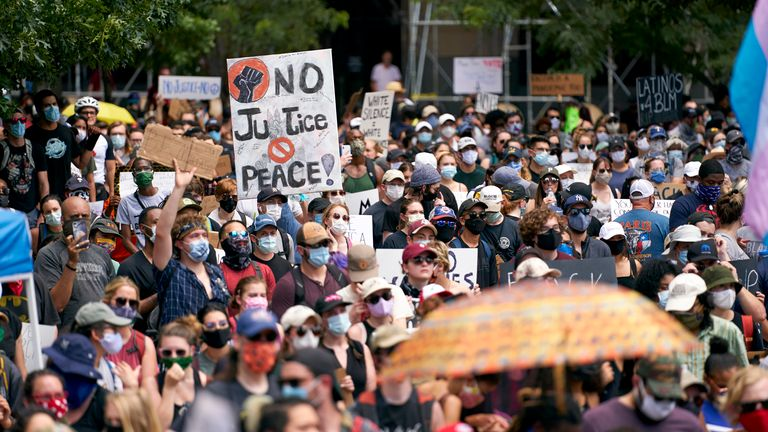 Demonstrators gather during a peaceful protest against police brutality and racism on June 6, 2020 in Dallas, Texas