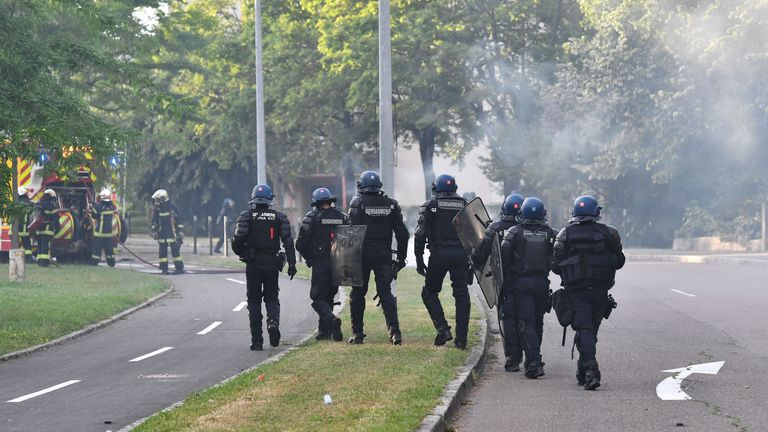 Gendarmes walk in a street in the Gresilles area of Dijon, eastern France, on June 15, 2020, as new tensions flared in the city after it was rocked by a weekend of unrest blamed on Chechens seeking vengeance for an assault on a teenager. - Police sources said the unrest was sparked by an attack on a 16-year-old member of the Chechen community on June 10. Members of the Chechen diaspora then set out on so-called punishment raids seeking to avenge the assault, they said. After three successive nig