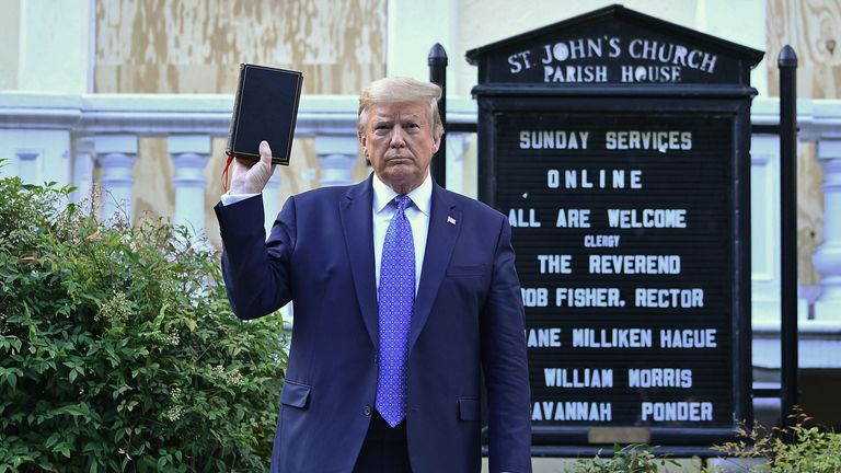 US President Donald Trump holds up a Bible outside of St John's Episcopal church across Lafayette Park in Washington, DC