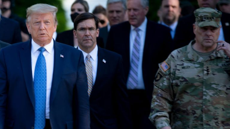 Donald Trump walks with Attorney General William Barr (L), US Secretary of Defense Mark T. Esper (C), Chairman of the Joint Chiefs of Staff Mark A. Milley (R)
