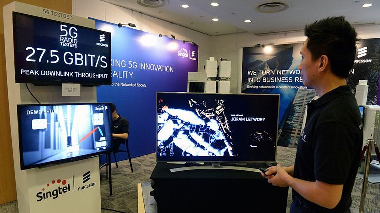 A staff member demonstrates video streaming at the maximum 27.5 bigabits per second peak downlink throughput connecting to a 5G radio testbed in Singapore on August 2, 2016. SingTel and Ericsson, the Swedish maker of wireless networking equipment, have teamed up to harness the potential of 5G technology in Southeast Asia. / AFP / ROSLAN RAHMAN (Photo credit should read ROSLAN RAHMAN/AFP via Getty Images)