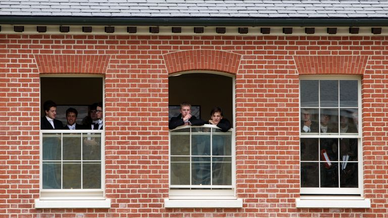 Eton College pupils watch as the Prince of Wales undertakes a visit to Eton College near Windsor, Berkshire where he officially opened the new Bekynton Field Development building.