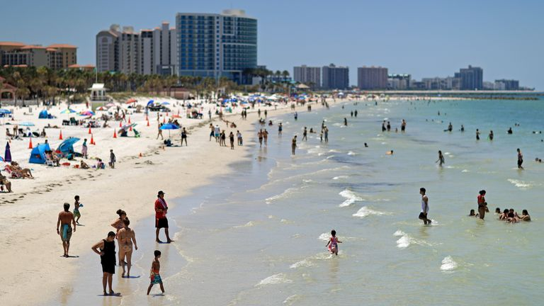 People on Clearwater Beach after beaches reopened Florida